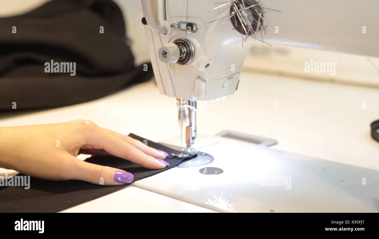 Tailor.Hands notch tailor tailor's scissors cloth. Female tailor stitching material at workplace. Preparing - Stock Image