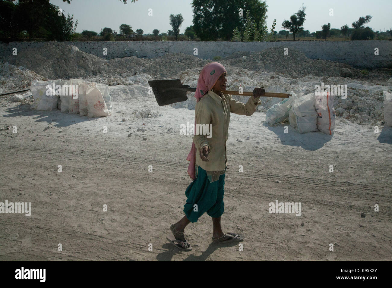 girl working n a field of lime stone, Rajasthan India - Stock Image