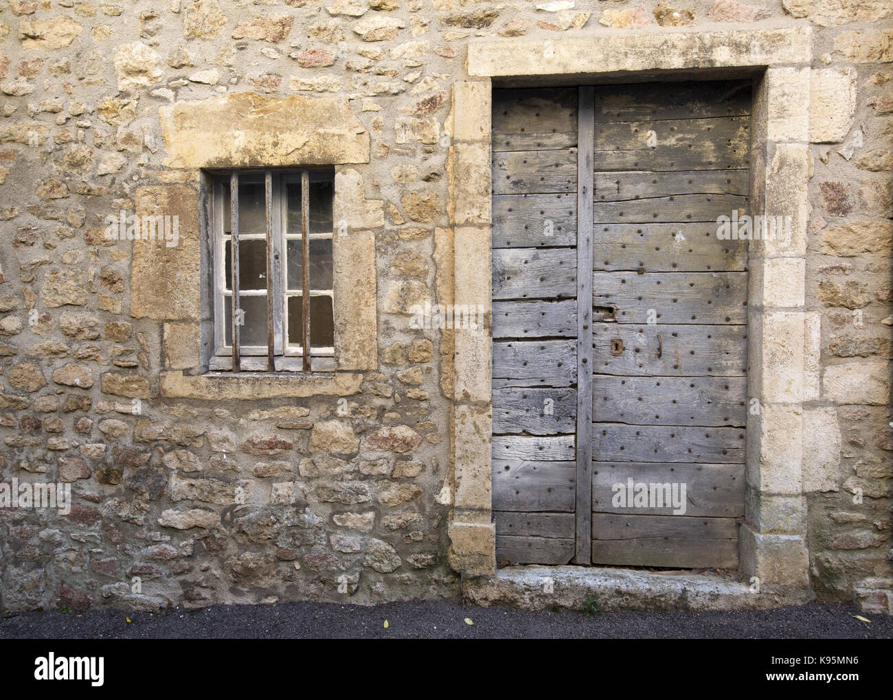 Ancient wooden door and window, Avallon, Yonne, Burgundy, France - Stock Image
