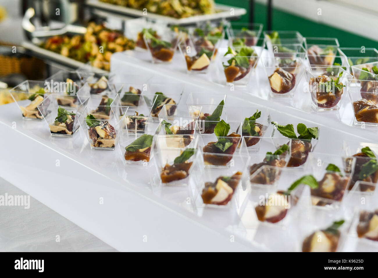 buffet table Canape sandwiches snacks holiday table sliced glasses celebration new year christmas fourchette catering table setting restaurant & buffet table Canape sandwiches snacks holiday table sliced ...