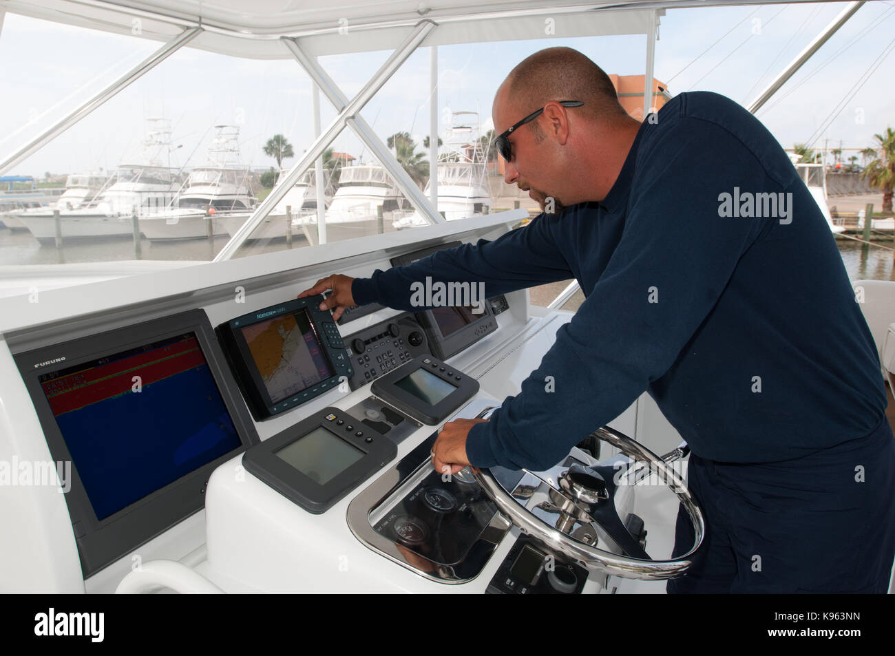 A sport fishing charter boat captain at the helm of his
