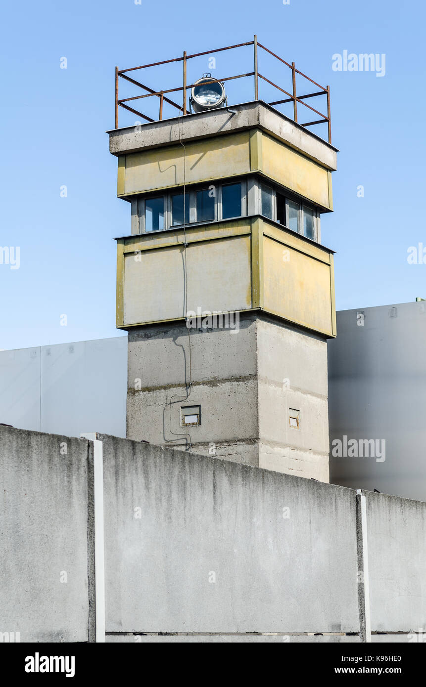 berlin wall memorial with an old watchtower - Stock Image