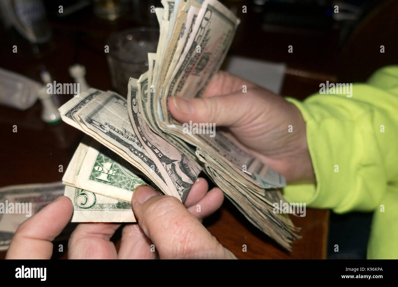 Paying restaurant bill from a wad of paper money. St Paul Minnesota MN USA - Stock Image