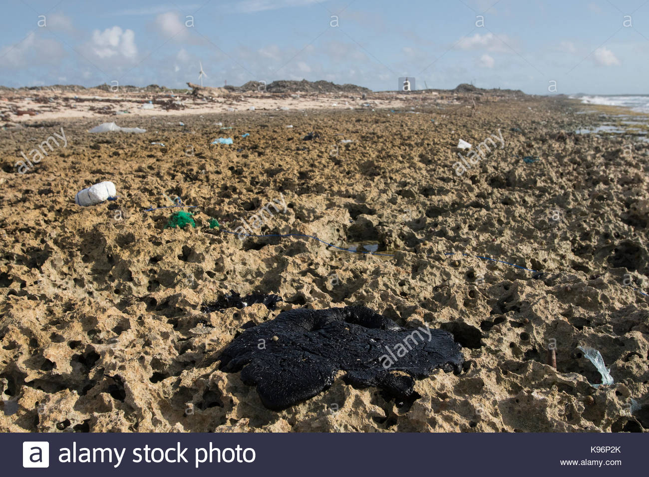 Crude oil along the east coast of Bonaire after a nearby oil spill in Trinidad. Stock Photo