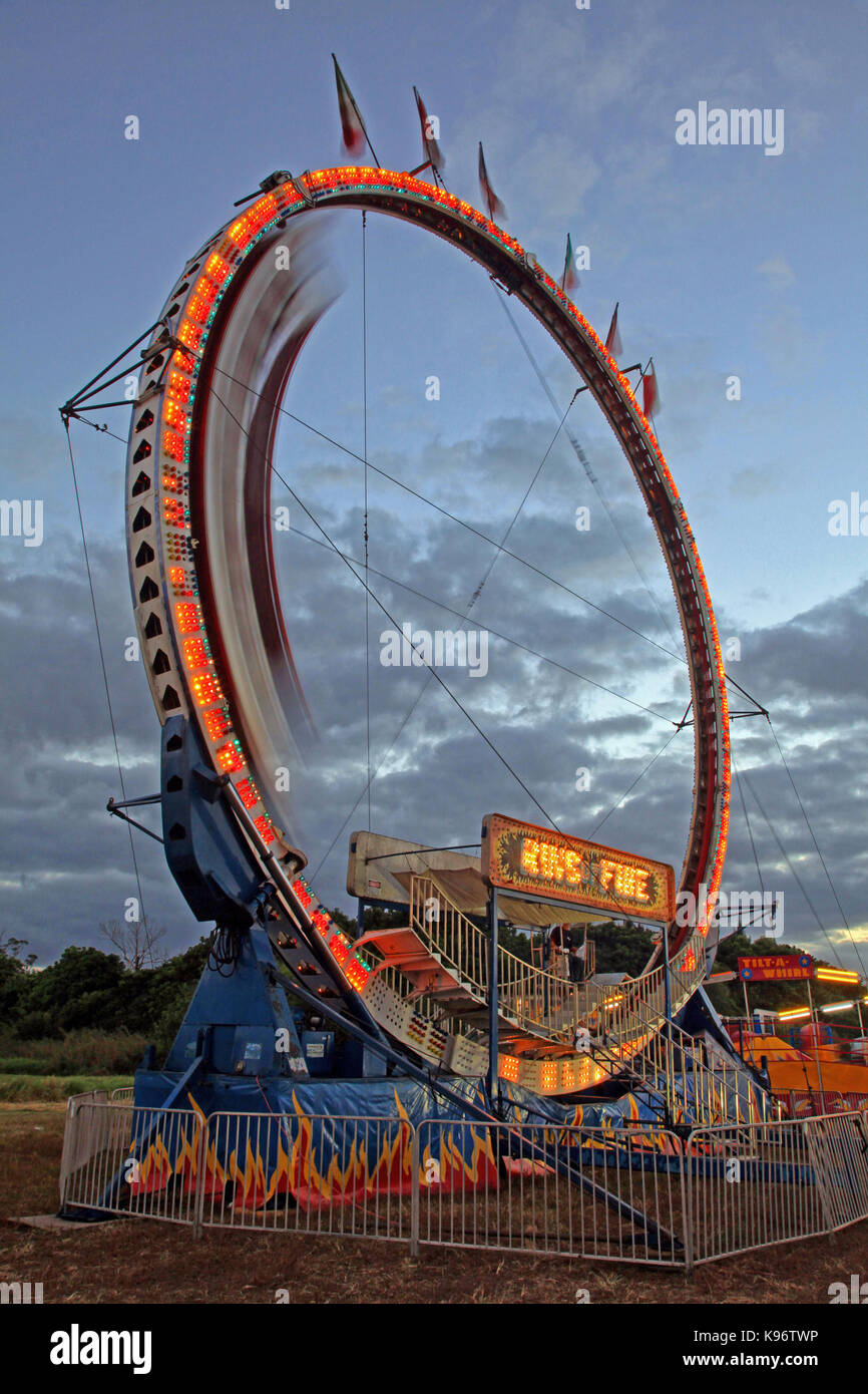 Ring of Fire amusement park ride in motion at dusk - Stock Image