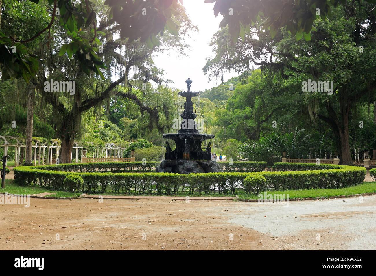 BOTANICAL GARDEN, RIO DE JANEIRO, BRAZIL - MARCH 15, 2016: Beautiful fountain surrounded by vegetation. Botanical Stock Photo