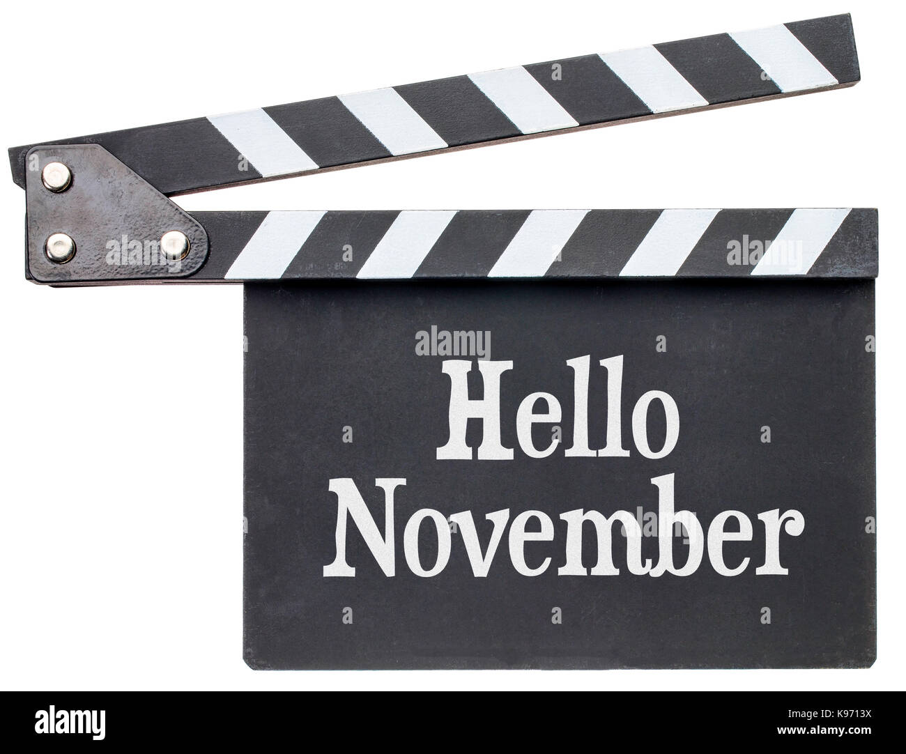 Hello November movie title in white chalk on clapboard isolated on white - Stock Image