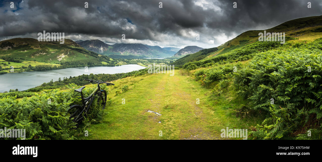 Mountain biking above Loweswater in the North-Western Lake District with heavy showers battering through the valley - Stock Image