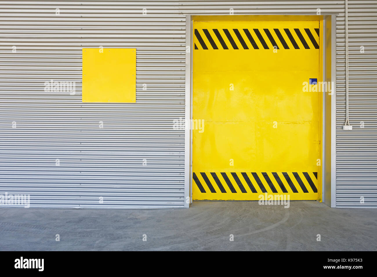 Big Yellow Gate Door at Distribution Warehouse - Stock Image