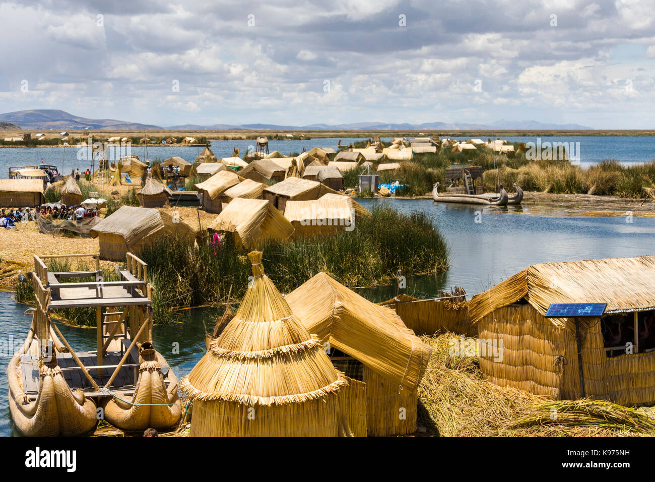 The Uros islands, reed houses and reed based islands in Lake Titikaka, Andes Highlands, Peru - Stock Image