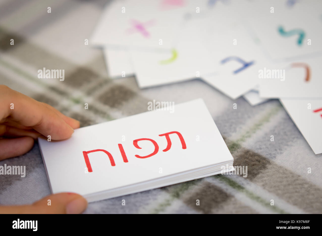 Hebrew; Learning the New Word with the Alphabet Cards (Translation; Apple) - Stock Image
