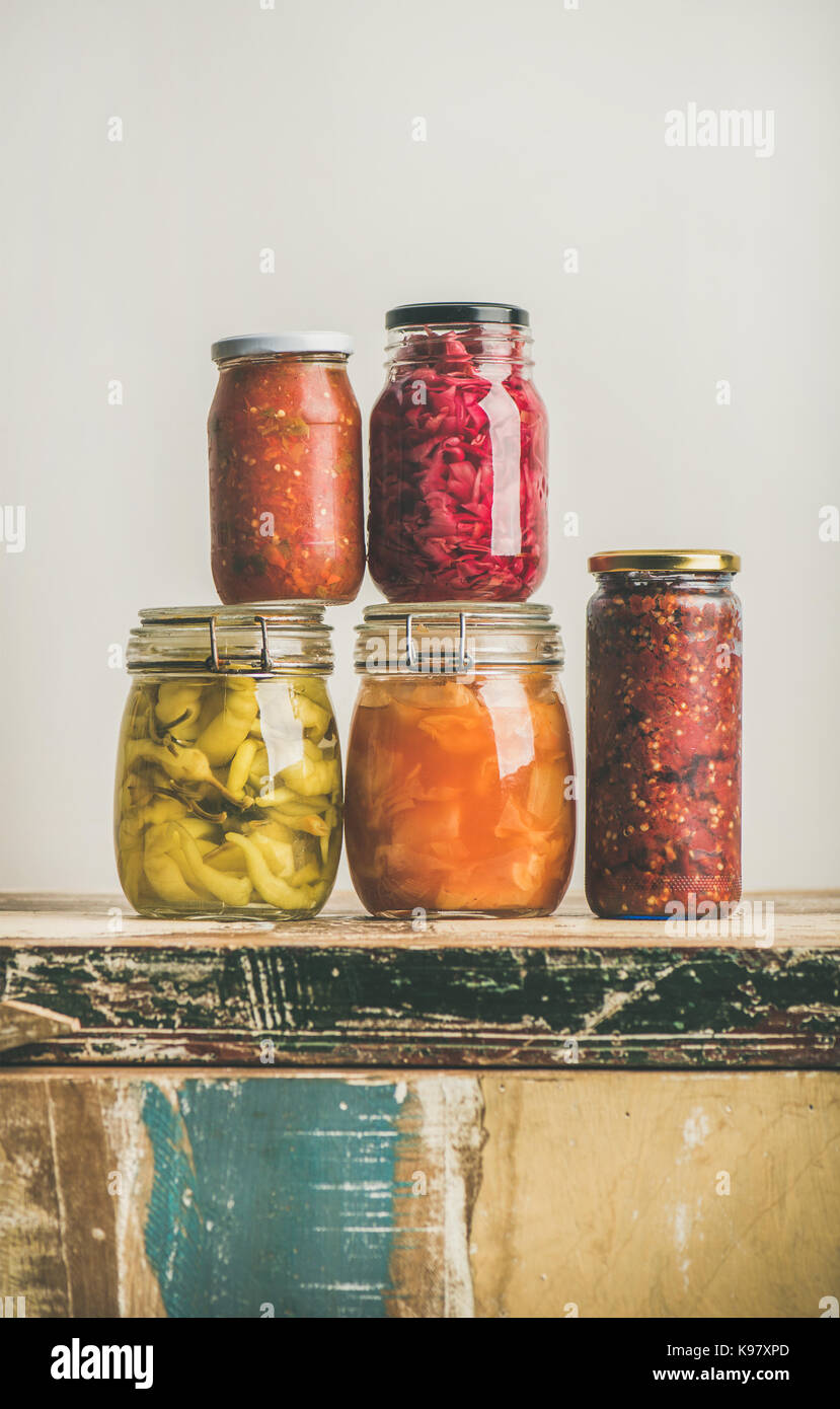 Autumn preserved pickled or fermented colorful vegetables in jars - Stock Image