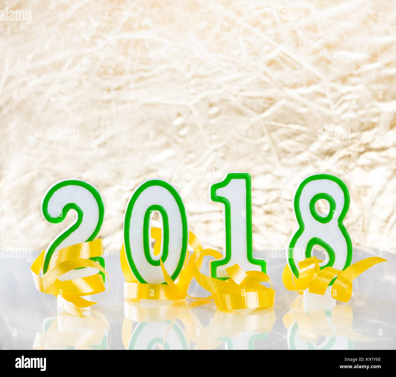 2018 New Year numbers and yellow ribbons on bright golden
