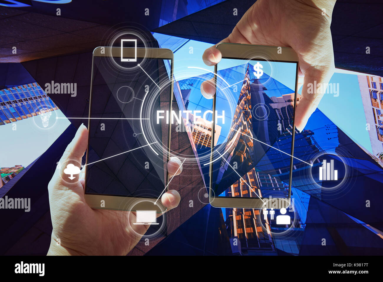 'Fintech' word on digital virtual screen with two businessman hands holding smartphones background. - Stock Image