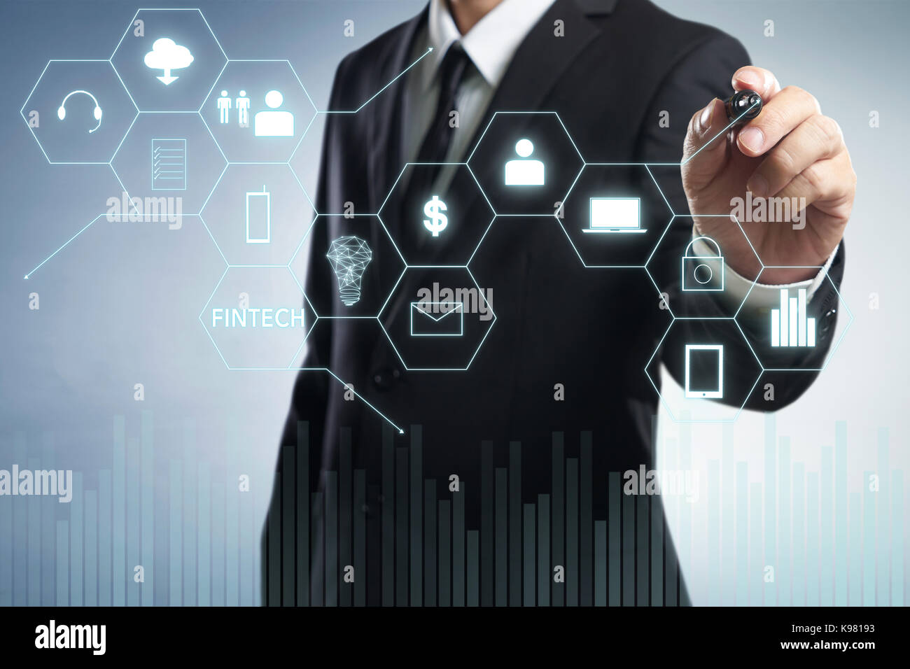 Businessman draw 'Fintech' word on digital virtual screen . Hi-tech business concept . - Stock Image