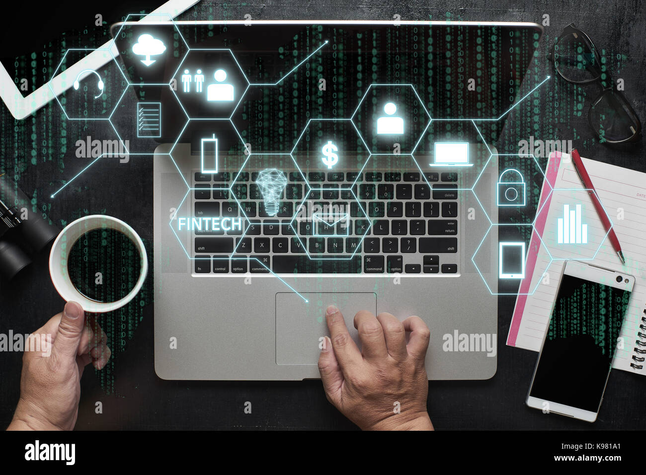 'Fintech' word on digital virtual screen with laptop, male hands, notebook,eyeglasses, sketchbook, black - Stock Image