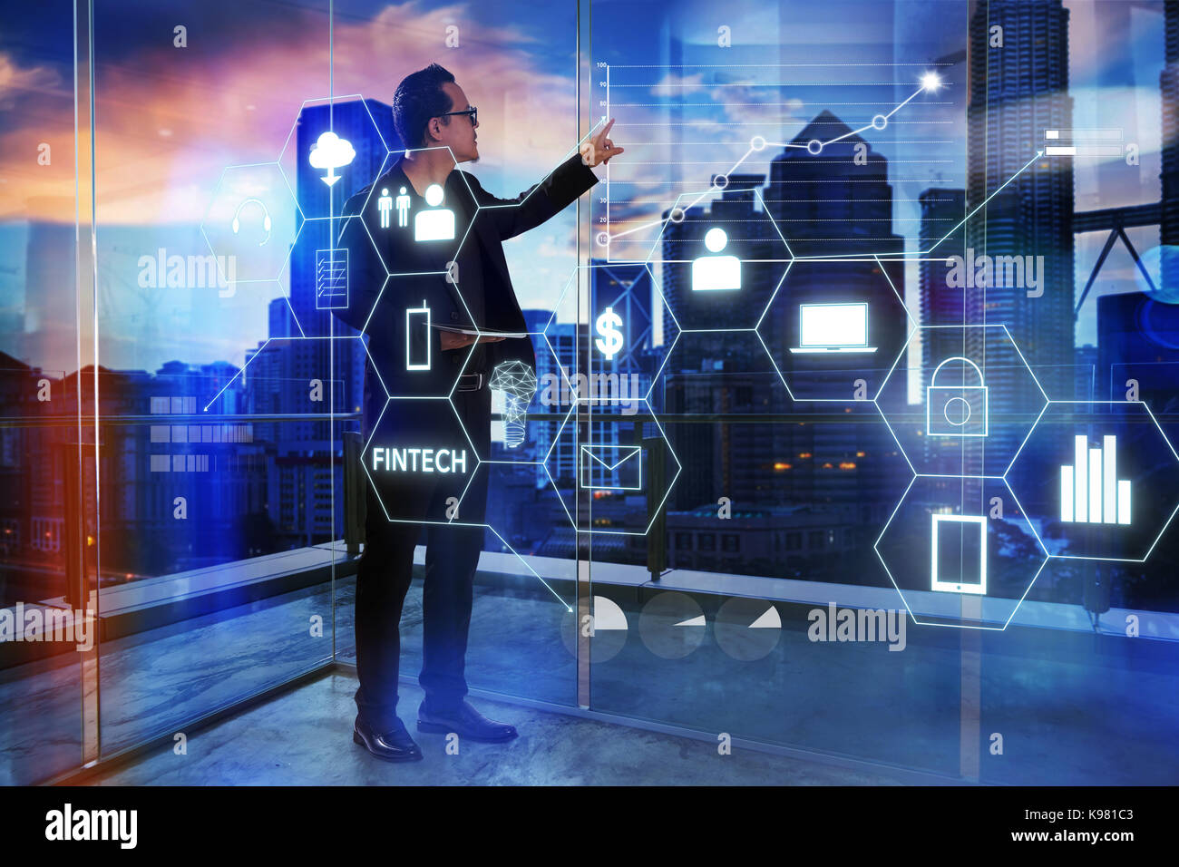 Businessman touching on digital virtual screen with fintech infographic icon . Hi-tech business concept . - Stock Image