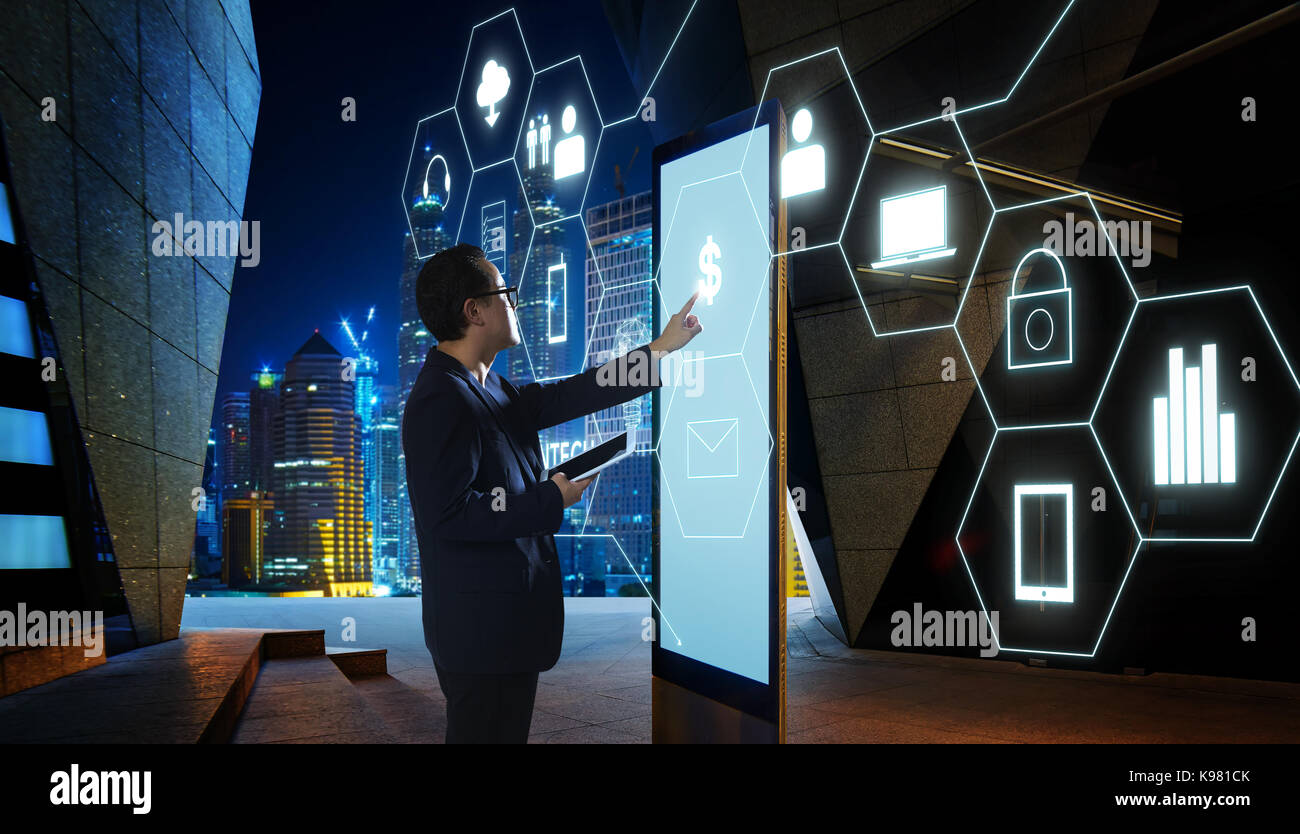 Businessman touching 'Money' sign on screen of digital booth with fintech infographic icon . Hi-tech business - Stock Image