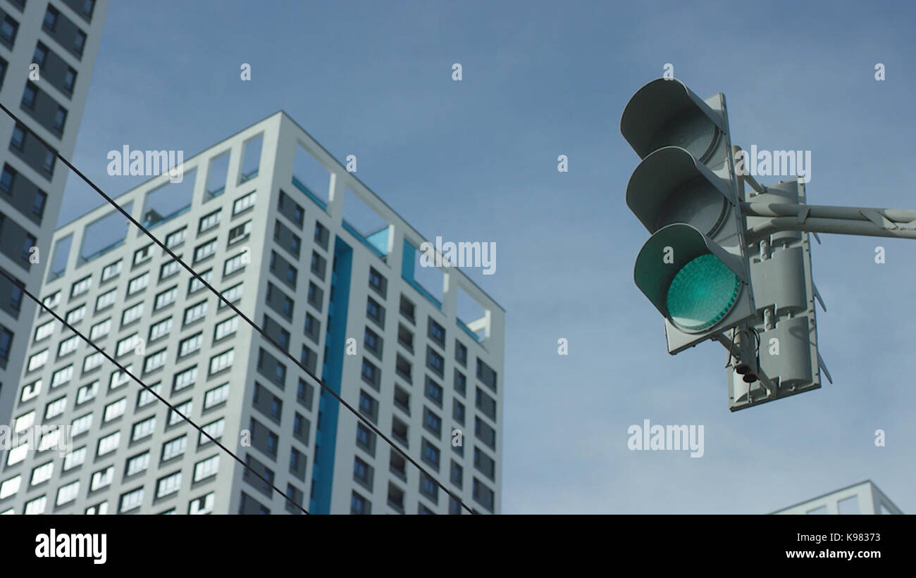 Traffic light changes from red to greent In The City. Traffic light In The City Stock Photo