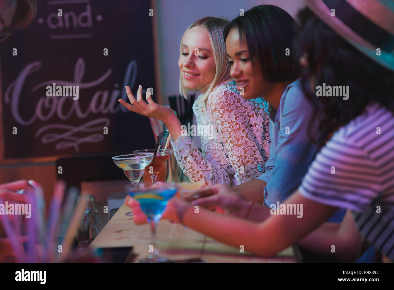 multicultural women having party - Stock Image