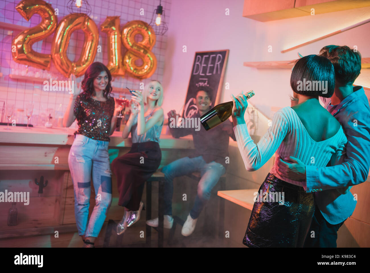 multiethnic friends at new year party - Stock Image