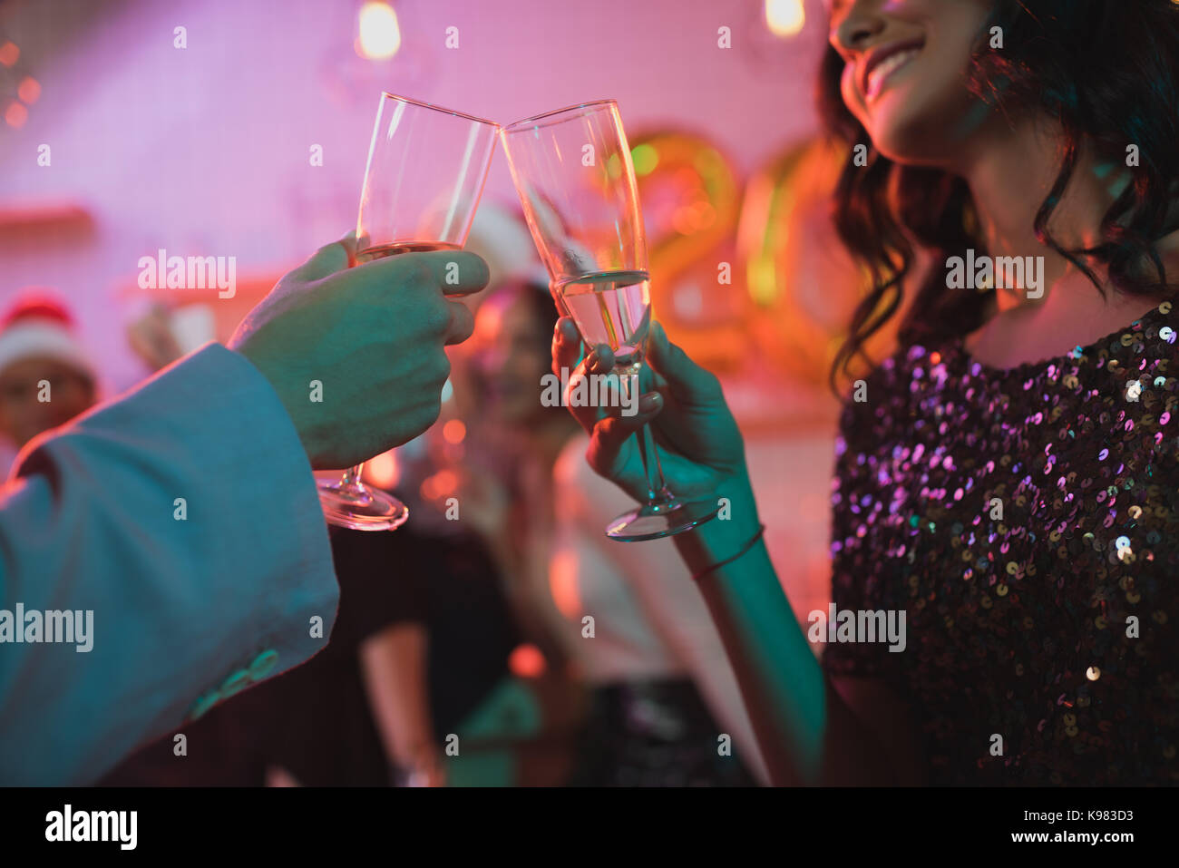 friends clinking glasses of champagne - Stock Image