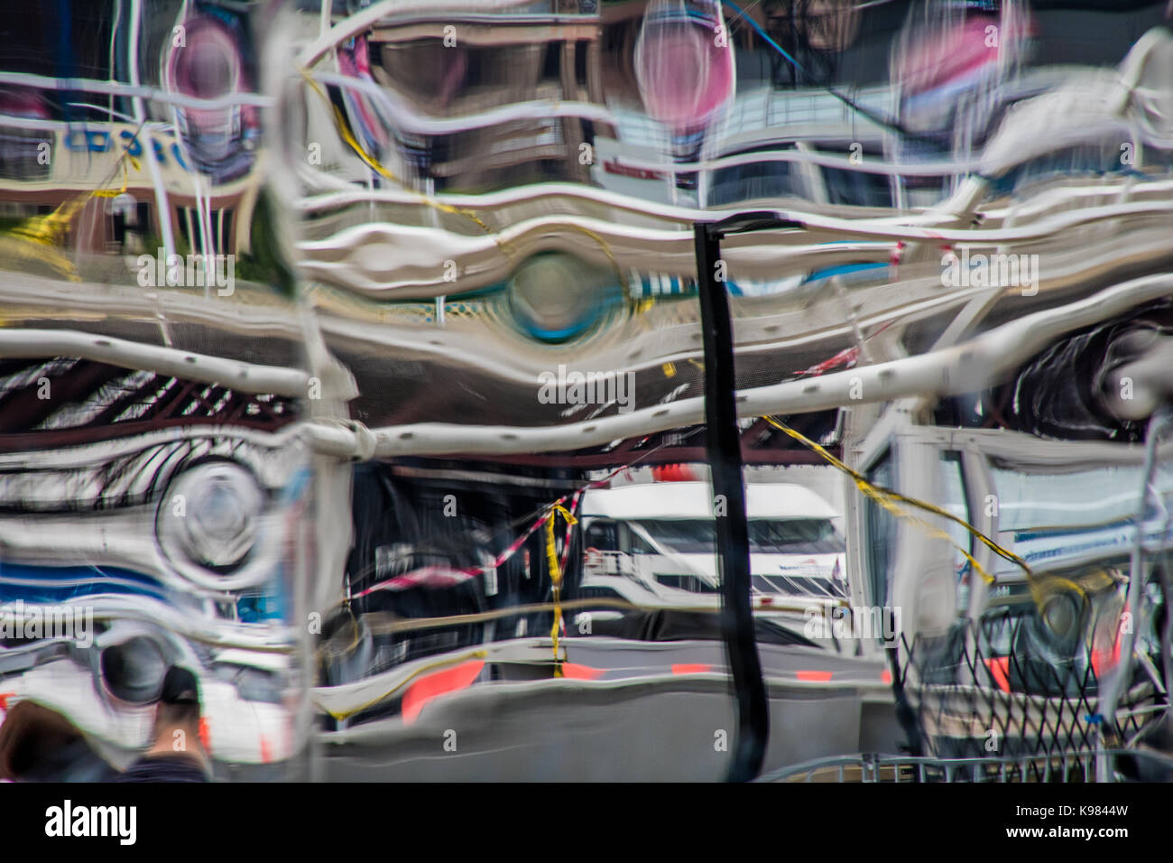 Abstract image distorted by a warped mirror - Stock Image