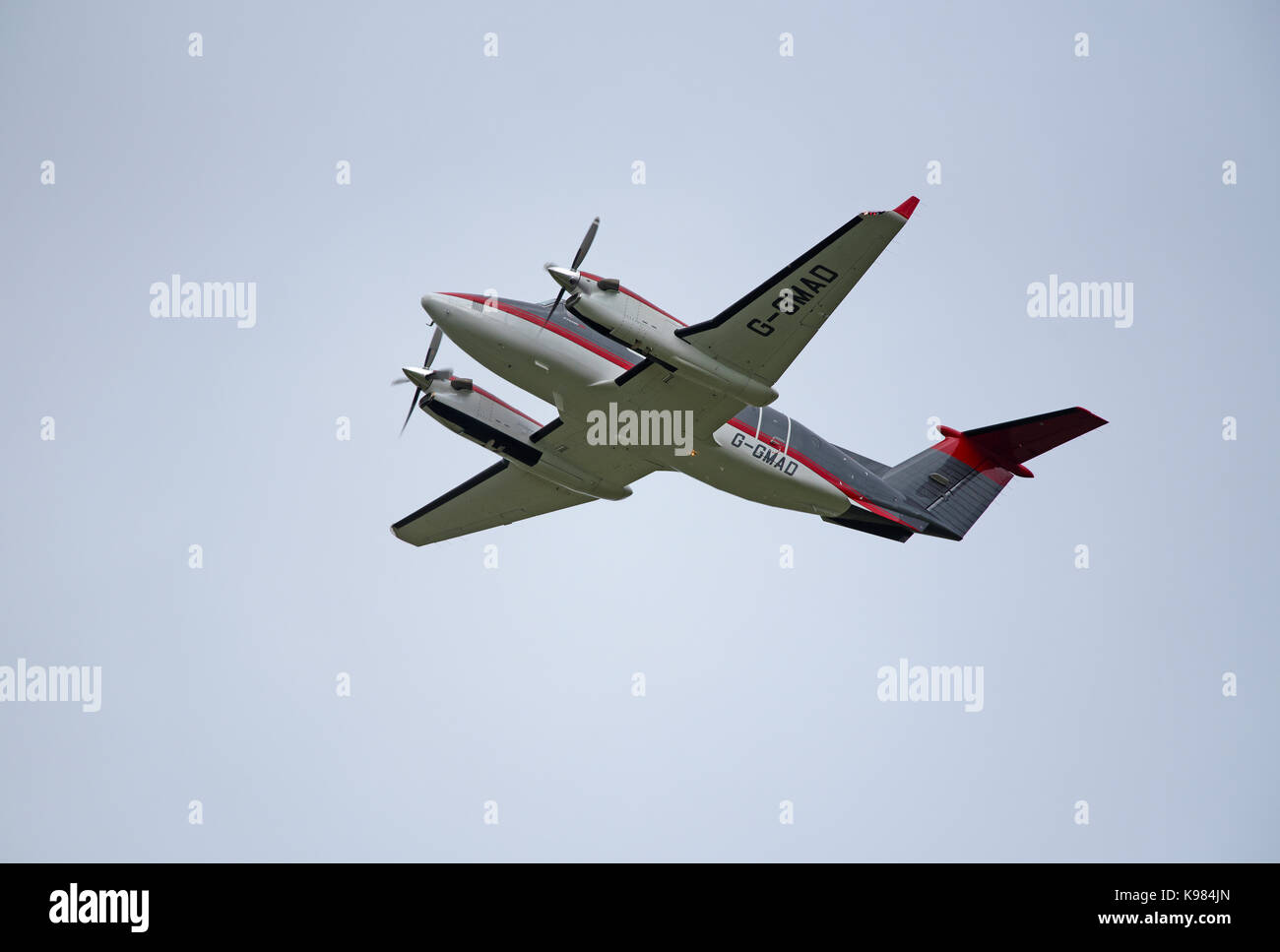 Twin Engined Beechcraft super King Air 350C G-GMAD Leaving Inverness Airport in the Scottish Highlands UK. - Stock Image