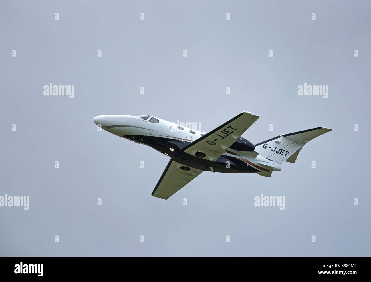 A Cessna Mustang on Charter departs Inverness Dalcross airport en-route to the USA. - Stock Image