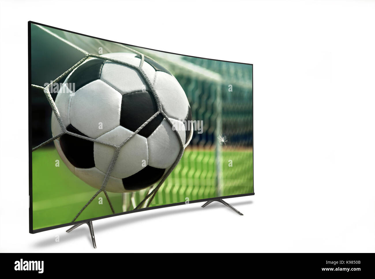 liquid crystal monitor on the background of the stadium broadcasts the match in the evening time of the World Cup - Stock Image
