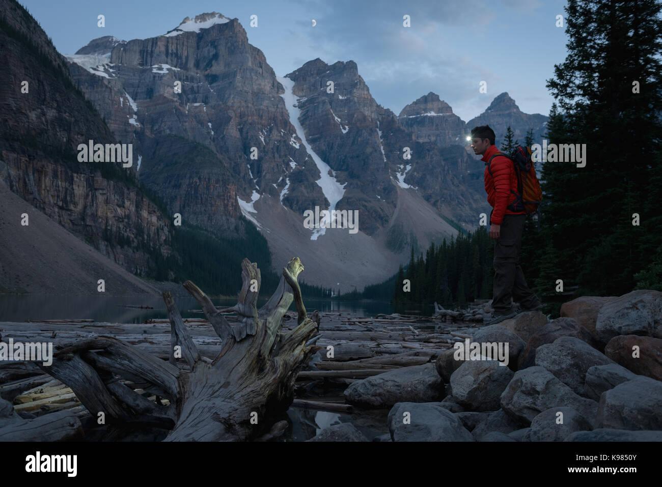 Hiker with headlamp hiking at night - Stock Image