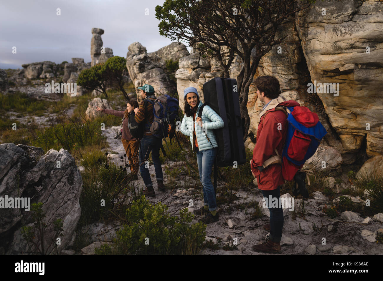 Group of hikers standing with rucksack during mountaineering - Stock Image