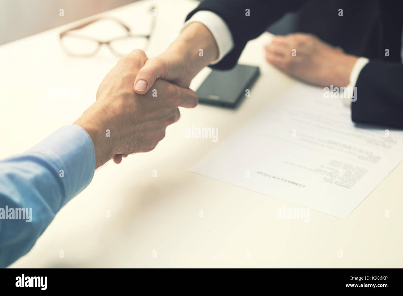 handshake after successful job interview at office - Stock Image