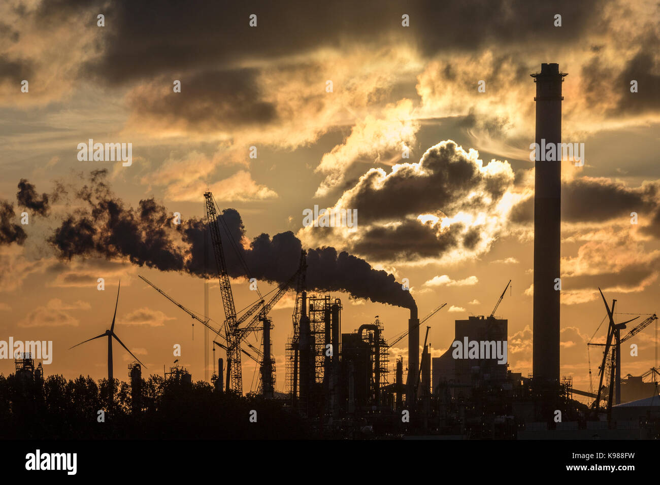 An industrial skyline at dusk - Rotterdam in the Netherlands. - Stock Image