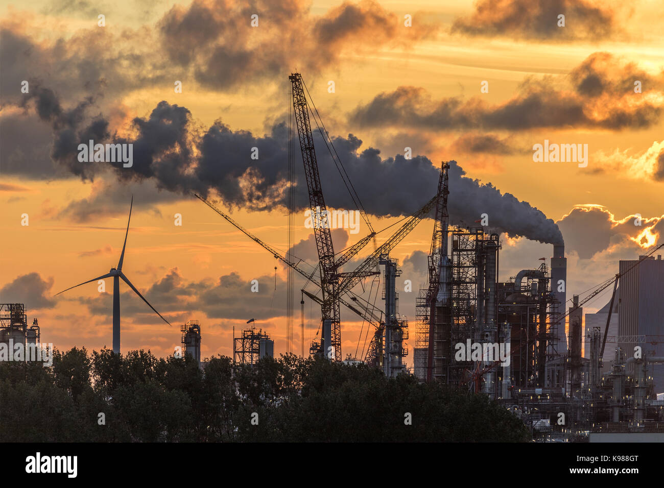 Industrial Pollution - An industrial skyline at dusk - Rotterdam in the Netherlands. - Stock Image