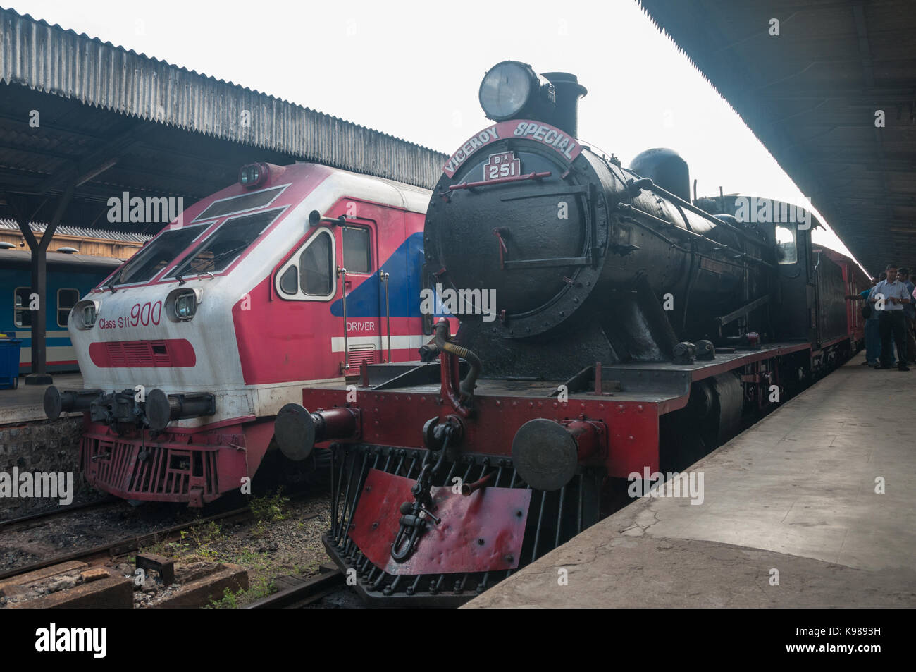 The Viceroy Special hauled by 251 Sir Thomas Maitland at Colombo Fort Station next to a Chinese made Class S11 diesel. - Stock Image