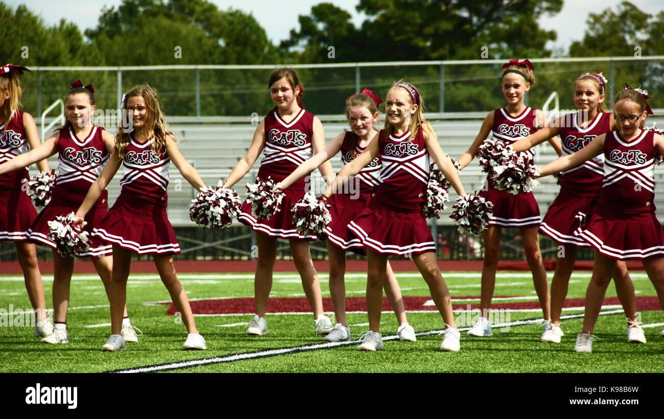 Cheerleaders Cheering - Stock Image