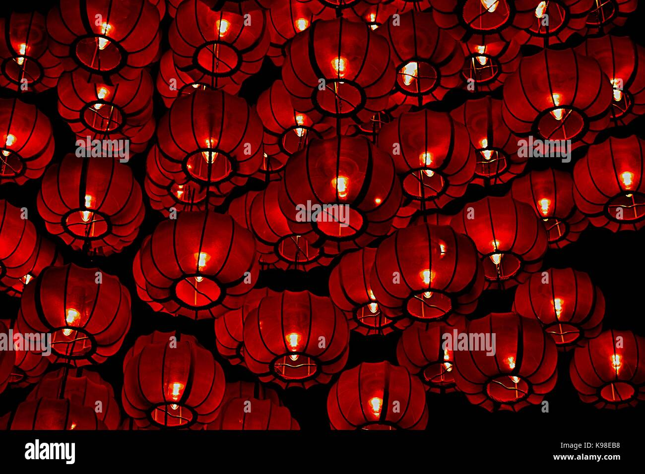 Red silk Chinese lanterns hanging in a large cluster during