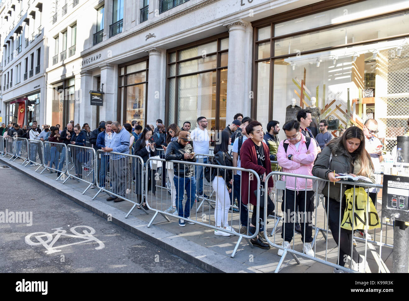 London, UK.  22 September 2017.  A modest queue of people is seen outside Apple's flagship store in Regent Street Stock Photo