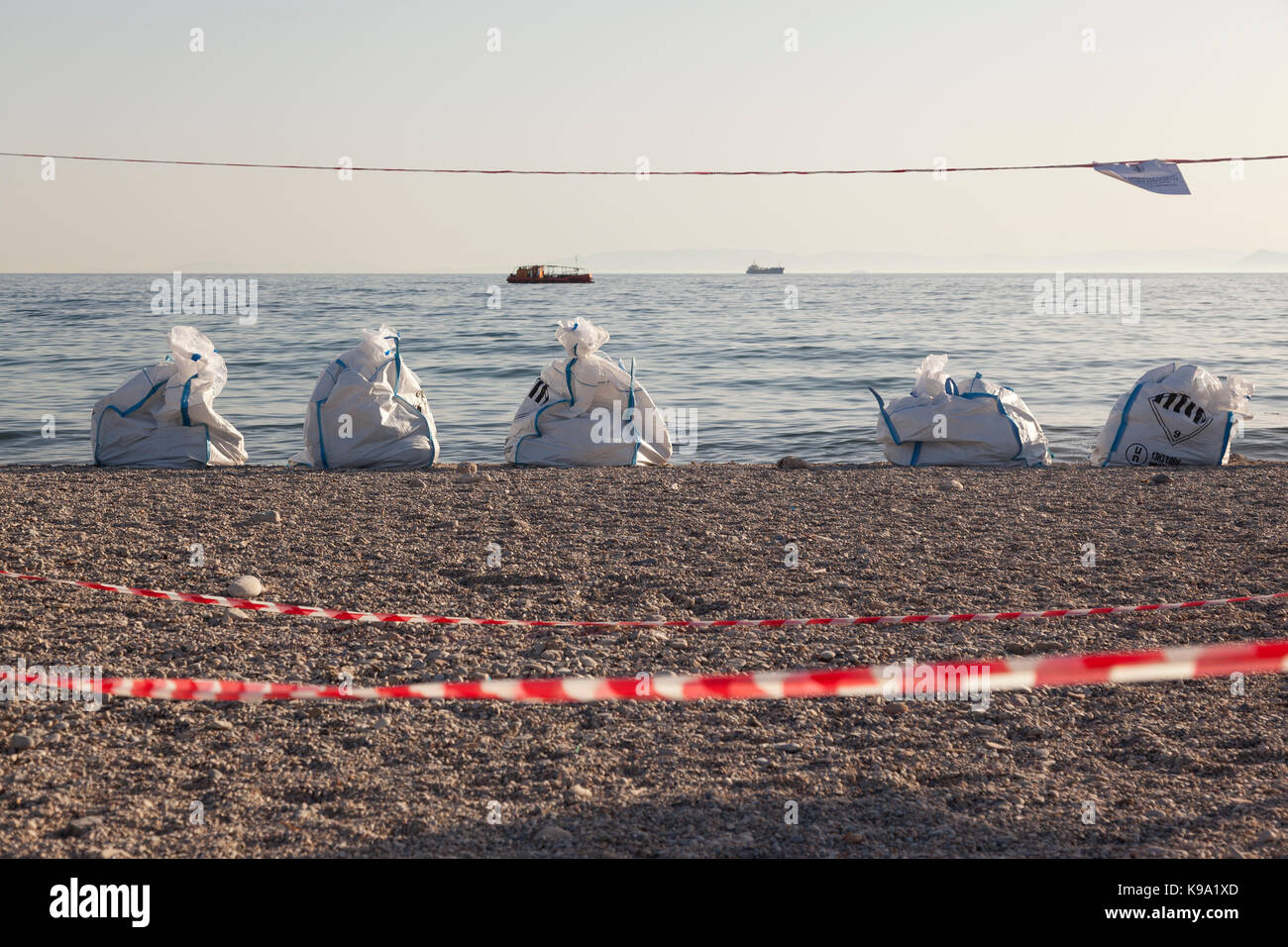 The beach of Glyfada, in Athens, Greece, during the days of the oil spill in the Saronic Gulf. - Stock Image