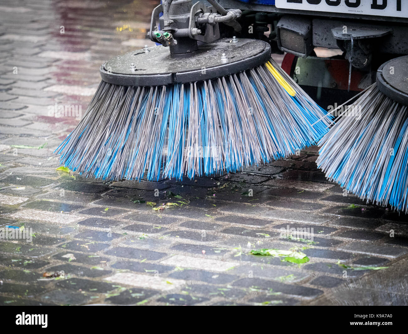 Street Sweeping Machine Brushes - a Street Sweeper pauses after clearing up debris in London's Soho after the - Stock Image