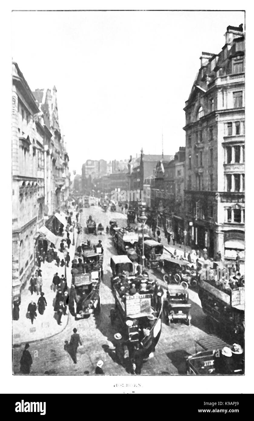 A view of horse-drawn and motor traffic in old Holborn London - Stock Image