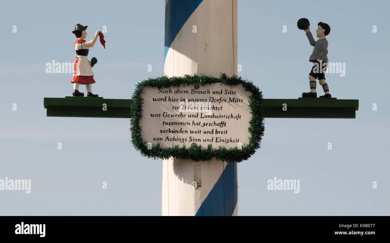 Detail view of traditional Maypole showing descriptive plaque and figurines, Aubing, near Munich, Germany, Europe. - Stock Image