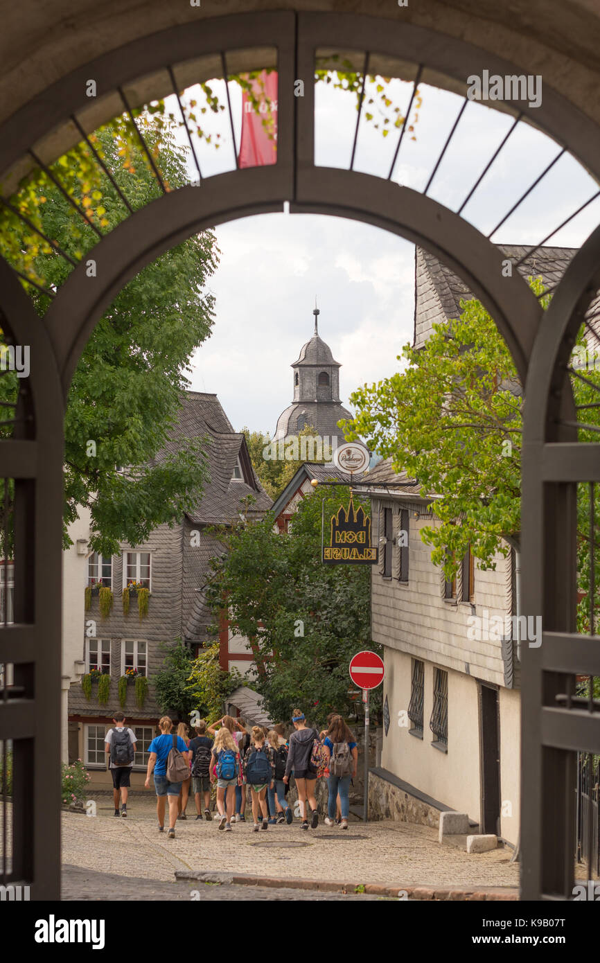 Group of schoolchildren walking Limberg old town, Germany, Europe. - Stock Image