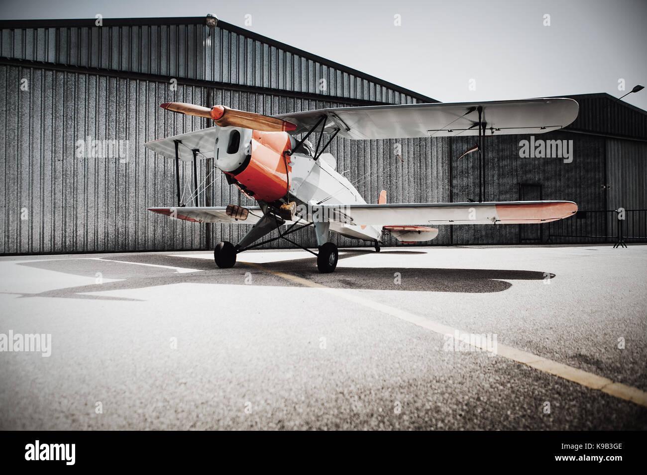 Beautiful vintage plane at the hangar. - Stock Image