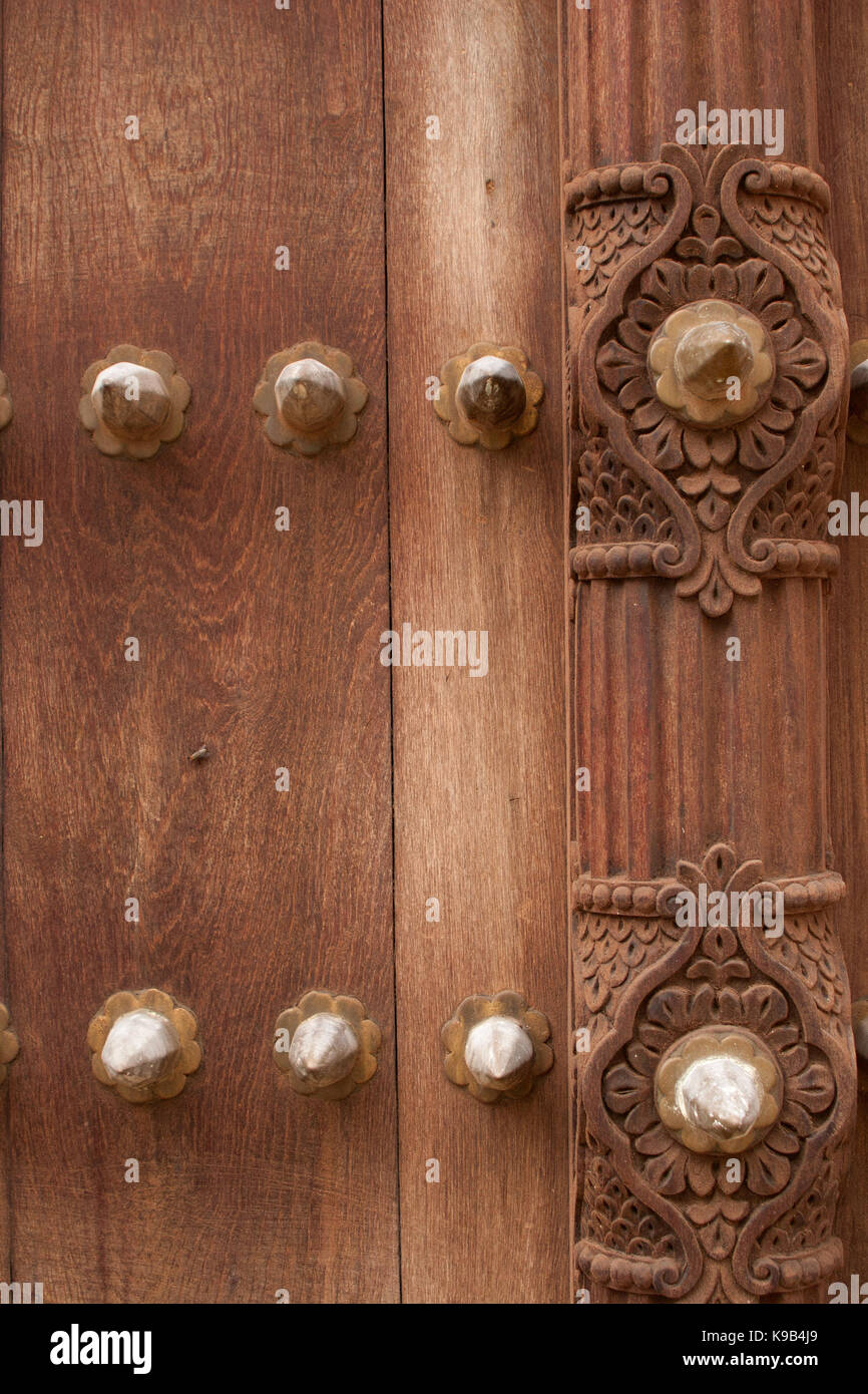 Detail on an ornate carved wooden door, Stone Town, Zanzibar, Tanzania, East Africa Stock Photo