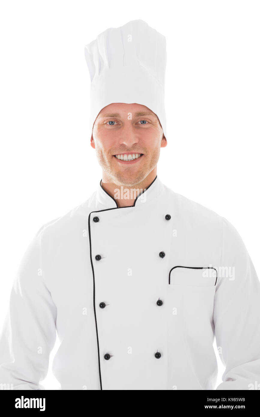 Portrait of happy mid adult male chef isolated over white background - Stock Image