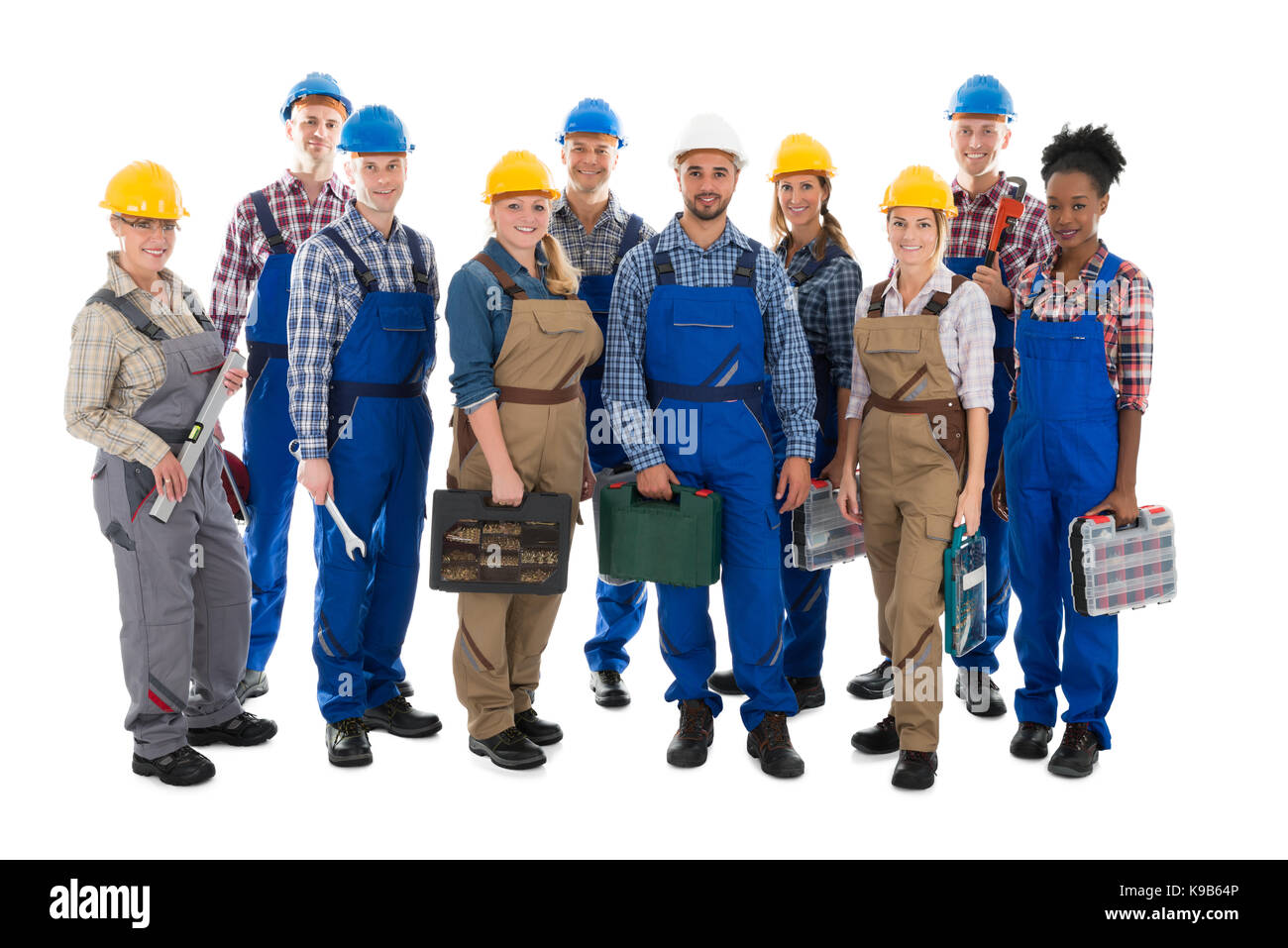 Full length portrait of confident carpenters carrying toolboxes against white background Stock Photo