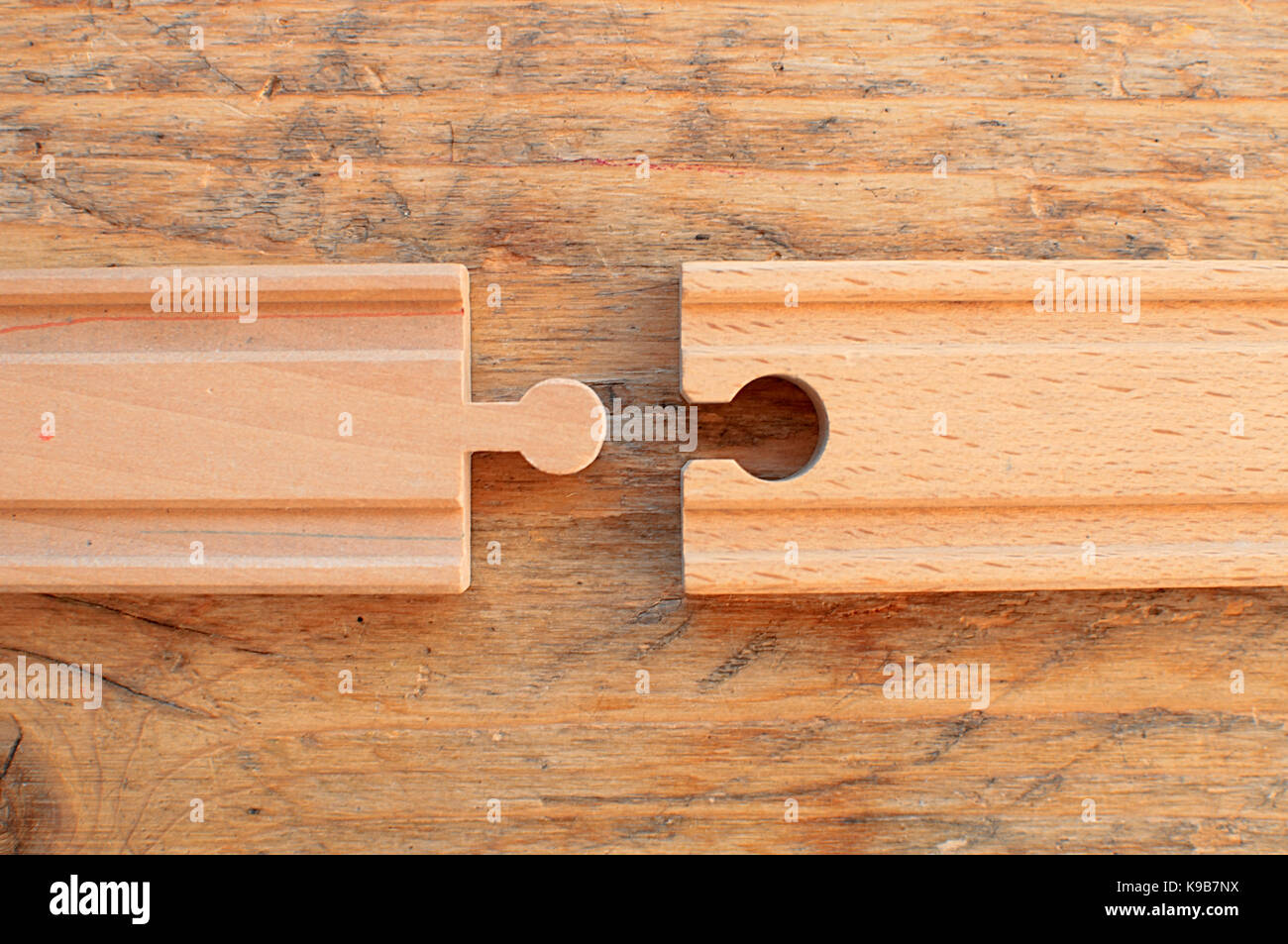 Two pieces of wooden toy train track not connected Stock Photo