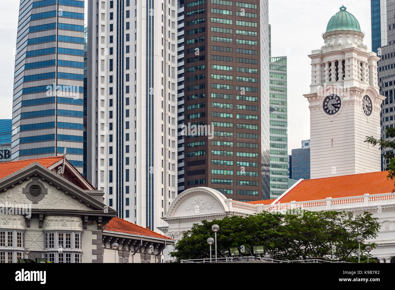 Central Business District, Singapore, with Singapore Cricket Club Clubhouse and Concert Hall Clock Tower - Stock Image